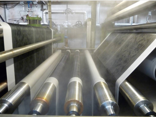 Fabrics being steamed to set the dyes in the fibers