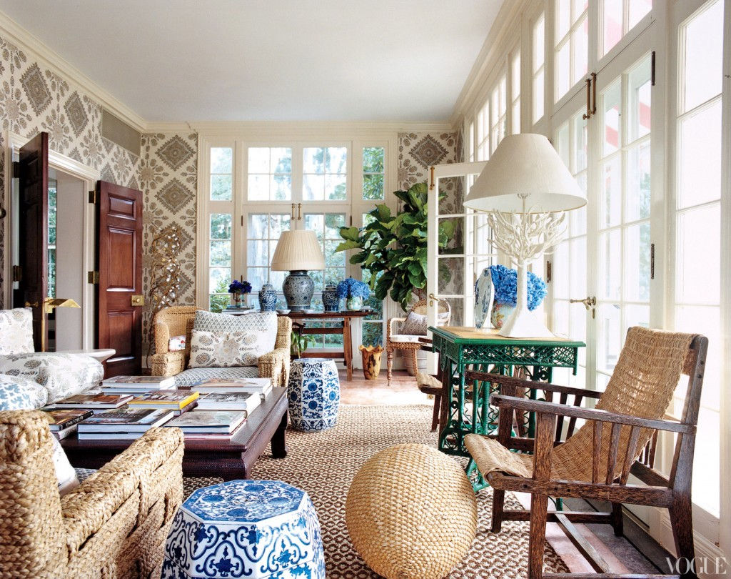 while outdoors, the dining table in Tory's trellis-paneled poolhouse ...
